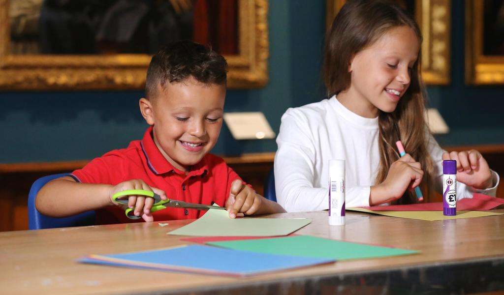 Image: A family taking part in a craft activity