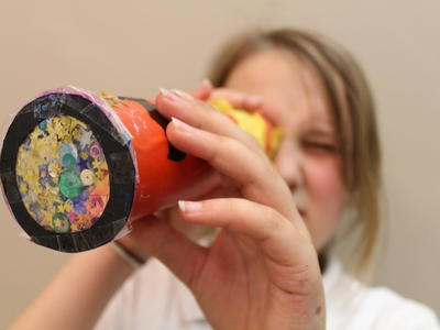 Image: Girl looking through a kaleidoscope